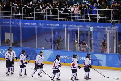 Fans cheer the combined Koreas team after the classification round of the women's hockey game against Sweden at the 2018 Winter Olympics in Gangneung, South Korea, Feb. 20, 2018. Sweden won 6-1.