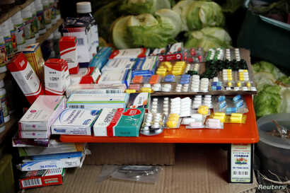 Medicines are displayed on sale in a fruit and vegetables stall at a market in Rubio, Venezuela, Dec. 5, 2017.