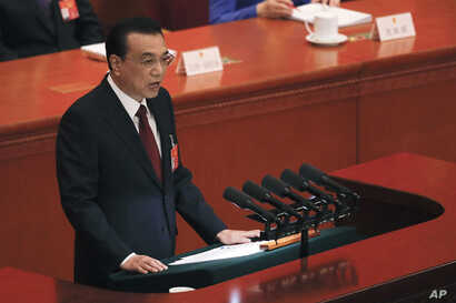 Chinese Premier Li Keqiang delivers his work reports at the opening session of the China's National People's Congress, at the Great Hall of the People in Beijing, China, March 5, 2019.