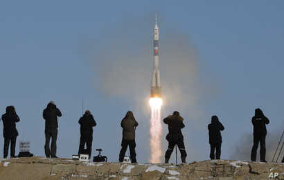 The Soyuz-FG rocket booster with Soyuz MS-07 space ship carrying a new crew to the International Space Station, ISS, blasts off at the Russian leased Baikonur cosmodrome, Kazakhstan, Sunday, Dec. 17, 2017.
