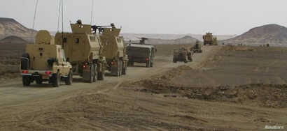 FILE - Egyptian Army vehicles are seen in the troubled northern part of the Sinai Peninsula during a launch of a major assault against militants, in Al Arish, Egypt, in this undated handout picture made available by the Ministry of Defense, March 4,