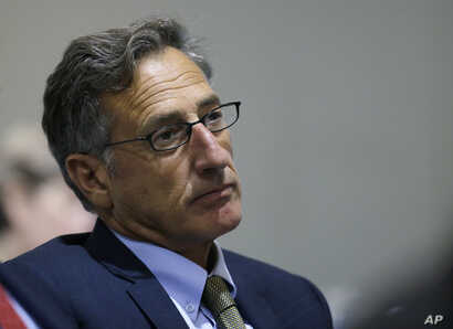 """FILE - Vermont Gov. Peter Shumlin, pictured at a New England-Canadian leaders conference in Boston in August 2016, says Americans should """"be both alarmed and outraged"""" by reports of Russian cyberattacks in the U.S."""