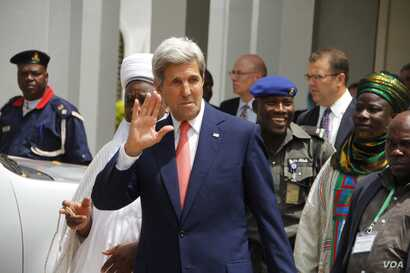 U.S. Secretary of State John Kerry waves after a visit to the sultan's palace in Sokoto, Nigeria, Aug. 23, 2016.