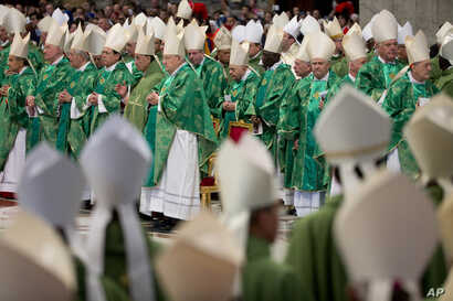 Pope Francis opened a divisive meeting of the world's bishops on family issues Sunday by forcefully asserting that marriage is an indissoluble bond between man and woman, St. Peter's Basilica at the Vatican, Oct. 4, 2015.