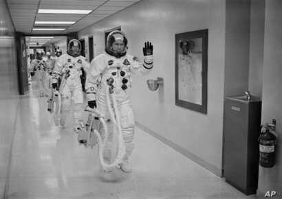 FILE - In this Dec. 21, 1968, file photo made available by NASA, Apollo 8 Commander Col. Frank Borman leads the way as he and fellow astronauts Command Module Pilot Capt. James A. Lovell Jr. and Lunar Module Pilot Maj. William A. Anders head to the l...