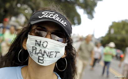An activist takes part in a rally held the day before the start of the Paris Climate Change Conference (COP21), in San Jose, Costa Rica, Nov. 29, 2015.