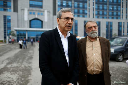 Turkish authors Orhan Pamuk, left, and Murat Belge leave Kartal Justice Palace after Belge appeared in court on charges of insulting Turkish President Tayyip Erdogan in Istanbul, May 3, 2016.
