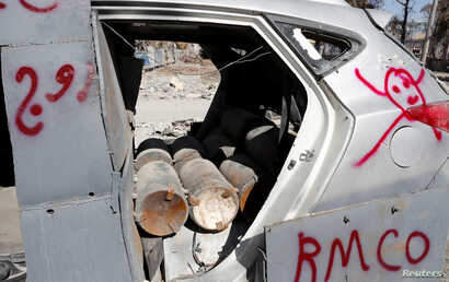 FILE - Bombs inside a vehicle used by the Islamic State militants in suicide car bombings are pictured after a demining team defused them in Raqqa, Syria, Oct. 18, 2017.