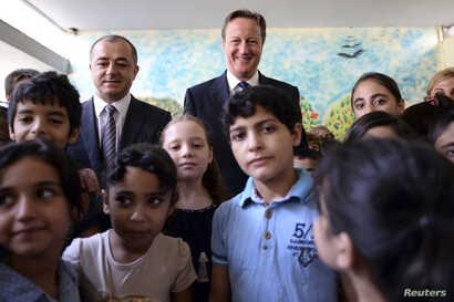Prime Minister David Cameron visits the Sed El Boucrieh School with Lebanese Education minister, Mr Elias Bou Saab, in Beirut, Lebanon, Sept. 14, 2015.