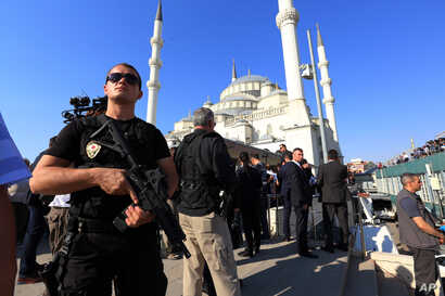 A Turkish special security force member stands during a mass funeral for the victims of a failed military coup last Friday, at Kocatepe Mosque in Ankara, Turkey, July 17, 2016.