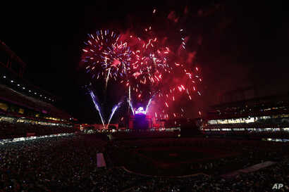 Fireworks explode over Coors Field to mark the Independence Day holiday after the Colorado Rockies hosted the Cincinnati Reds in a baseball game, July 3, 2017, in Denve, Colorado.r.