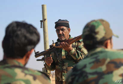 Abbas Hamza Hassan, a 56-year-old Iraqi fighter who in 2014 left the southern Iraqi province of Basra to join the forces of the paramilitary units of the Hashed Shaabi (Popular Mobilization) against Islamic State group (IS), is pictured on Nov. 13, 2...