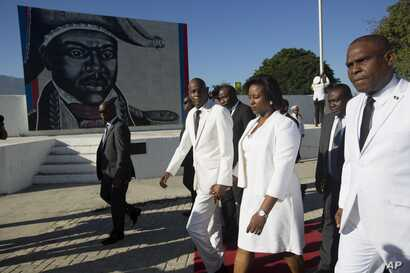 Haiti's President Jovenel Moise, center, and first lady Martine Moise walk with Prime Minister Jean Henry Ceant as they leave a ceremony marking the 212th anniversary of the assassination of independence hero Gen. Jean-Jacques Dessalines, in Port-au-...