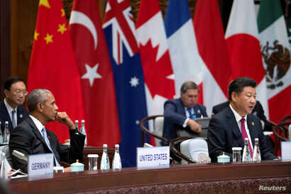 U.S. President Barack Obama watches as Chinese President Xi Jinping speaks at the opening ceremony of the G20 Summit in Hangzhou, Zhejiang province, China, Sept. 4, 2016.