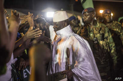 Incumbent Gambian President Yahya Jammeh, leader of the APRC (The Alliance for Patriotic Reorientation and Construction) greets his suporters in Bikama, Nov. 24, 2016 during an electoral rally.