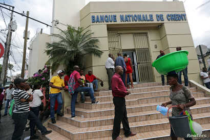 People line up outside a bank at a neighborhood in Port-au-Prince, Haiti, Feb. 16, 2019.