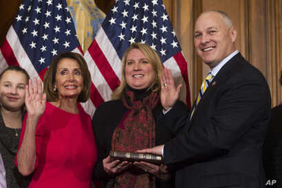 House Speaker Nancy Pelosi of Calif., right, poses during a ceremonial swearing-in with Rep. Pete Stauber, R-Minn., on Capitol Hill in Washington, Thursday, Jan. 3, 2019, during the opening session of the 116th Congress. Washington, Thursday, Jan. 3,...