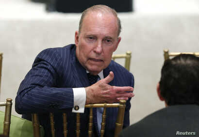 Larry Kudlow, director of the National Economic Council, speaks with another attendee as U.S. President Donald Trump hosts a joint press conference with Japan's Prime Minister Shinzo Abe at Trump's Mar-a-Lago estate in Palm Beach, Florida, April 18,