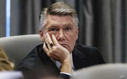 Mark Harris, Republican candidate in North Carolina's 9th congressional race, listens to testimony during a public evidentiary hearing on the 9th congressional district voting irregularities investigation, Feb. 19, 2019, at the North Carolina State B...