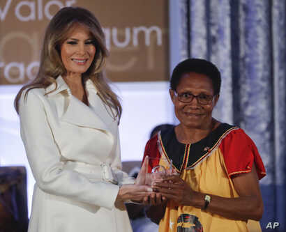 First lady Melania Trump presents the 2017 Secretary's of State's International Women of Courage (IWOC) Award to Veronica Simogun from Papua New Guinea, March 29, 2017, at the State Department in Washington.