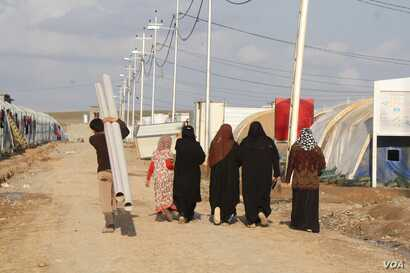 Wives of captured or killed IS fighters say they had no capacity to stop their husbands from joining the group in their conservative society, pictured on Feb. 28, 2018 in Haj Ali, Iraq.