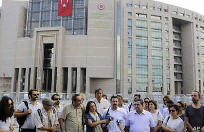 Journalist gather outside a court building in Istanbul, Turkey, to support their colleague journalist Bulent Mumay, who was detained in connection with the investigation launched into the failed coup attempt, July 27, 2016.