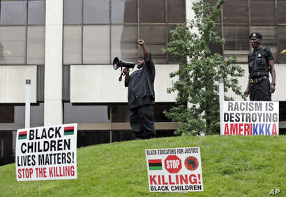 People participate in a rally against racism, injustice and white supremacy, in Perk Park, before the Republican National Convention in Cleveland, Ohio, July 16, 2016.