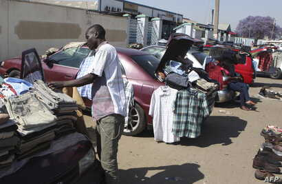 FILE - Hawkers sell goods on the streets of Harare, Sept. 17, 2015.