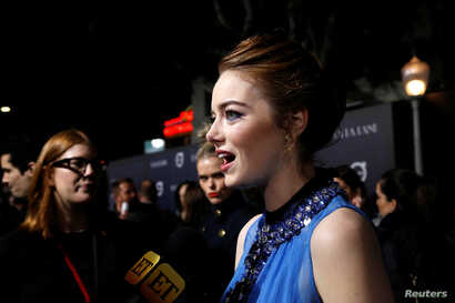 "Cast member Emma Stone is interviewed at the premiere of ""La La Land"" in Los Angeles, Dec. 6, 2016. The musical was named one of 2016's top 10 movies by the American Film Institute, Thursday, Dec. 8, 2016."