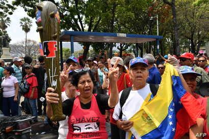 "Supporters of Venezuelan President Nicolas Maduro take part in a pro-government ""Anti-Imperialist March"" in Caracas, March 30, 2019."