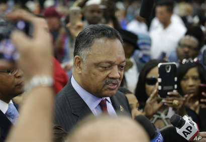 American civil rights activist Jesse Jackson speaks to members of the media before Muhammad Ali's Jenazah, a traditional Muslim service, at Freedom Hall in Louisville, Ky., June 9, 2016.