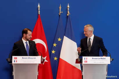 French Finance Minister Bruno Le Maire and Turkish Finance Minister Berat Albayrak attend a joint news conference after a meeting at the Bercy Finance Ministry in Paris, France, Aug. 27, 2018.