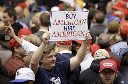 A supporter of President Donald Trump holds up a sign at a rally, March 15, 2017, in Nashville, Tennessee.