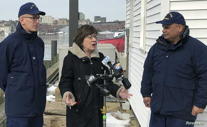 U.S. Sen. Susan Collins, R-Maine, addresses reporters after a ribbon-cutting at a U.S. Coast Guard regional command center, Feb. 20, 2019, in South Portland, Maine. Collins said that she would vote for a congressional resolution disapproving of Presi...