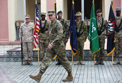 New Commander of Resolute Support forces and United States forces in Afghanistan, U.S. Army General John Nicholson Campbell take part in a change of command ceremony in Kabul, March 2, 2016.