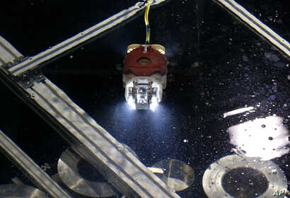 A newly developed robot for underwater investigation of a Fukushima damaged reactor moves through the water at a test facility in Yokosuka near Tokyo, June 15, 2017.