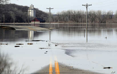 The Missouri River floods across and closes K-7 highway near White Cloud, Kansas, March 18, 2019.