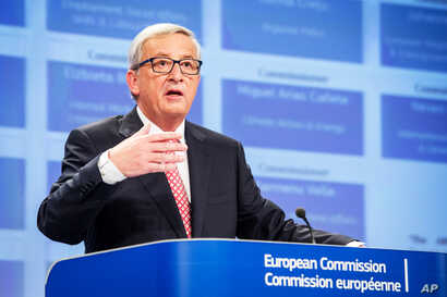 European Commission President-elect Jean-Claude Juncker addresses the media on the attribution of portfolios to the Commissioners-designate at the European Commission headquarters in Brussels, Sept. 10, 2014.