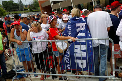 Supporters wait to see U.S. Republican presidential candidate Donald Trump speak at a campaign rally at the Sharonville Convention Center in Cincinnati, Ohio July 6, 2016.