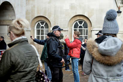 Armed police patrol busy public areas around Westminster as security is stepped up ahead of New Year's Eve celebrations in London, Dec. 30, 2017.