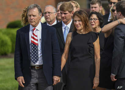 Fred and Cindy Warmbier watch as their son Otto's casket is placed in a hearse after funeral services, in Wyoming, Ohio, June 22, 2017.