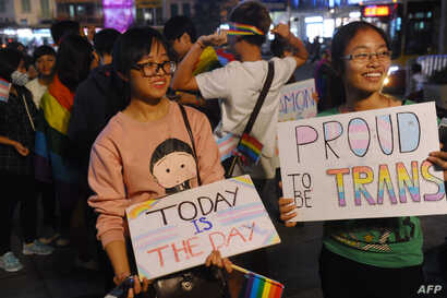 Members from the local lesbian, gay, bisexual and transgender (LGBT) community gather to celebrate a law newly approved by the National Assembly on transgenders in Hanoi, Nov. 24, 2015.