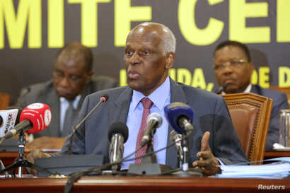 FILE - Jose Eduardo dos Santos, Angola's president at the time, attends a party meeting in Luanda, Angola, Dec. 2, 2016.