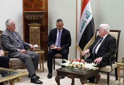 U.S. Secretary of State Rex Tillerson, left, listens as Iraqi President Fuad Masum speaks during their meeting, Oct. 23, 2017, in Baghdad, Iraq.