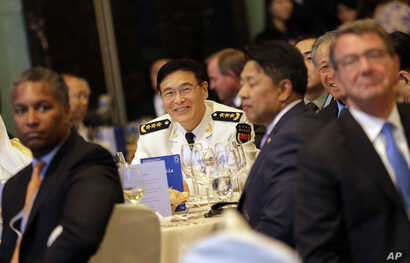 China's Joint Staff Department Deputy Chief Adm. Sun Jianguo, center, attends the Opening Dinner of the 15th International Institute for Strategic Studies Shangri-la Dialogue, or IISS, Asia Security Summit, in Singapore, June 3, 2016. U.S. Defense Se...