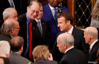 French President Emmanuel Macron greets members of Congress after a joint meeting of Congress in the House chamber of the U.S. Capitol in Washington, April 25, 2018.