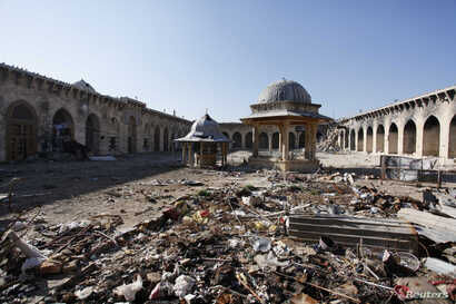 A general view of damage in the Umayyad mosque of Old Aleppo, Syria, Dec. 15, 2013.