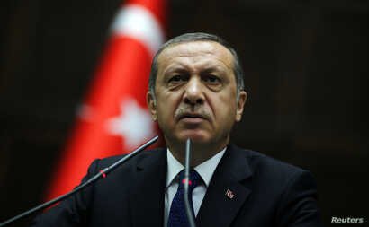 FILE - s Prime Minister Tayyip Erdogan addresses members of parliament from his ruling AK Party (AKP)  at the Turkish parliament in Ankara,June 3, 2014.