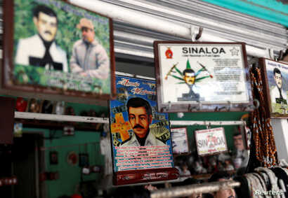 "Souvenirs of ""Malverde"" are pictured in a store beside the ""Saint Jesus Malverde"" chapel in Culiacan, in Mexico's state of Sinaloa September 9, 2018."