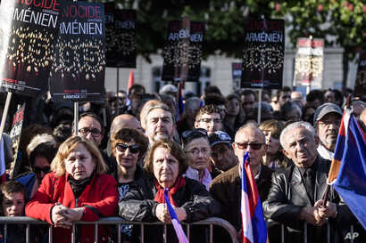 French Armenians listen to the speech of French President Francois Hollande during a ceremony marking the 102nd anniversary of the slaying of Armenians by Ottoman Turks, in Paris, April 24, 2017.